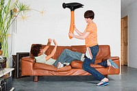 Couple playing with inflatable hammer