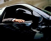 Businessman in a car (thumbnail)