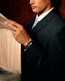 Businessman reading financial newspaper