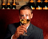 Man holding wine glass in front of his face