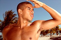 Young man on beach (thumbnail)