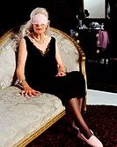 Senior woman wearing eye mask