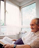 Elderly man with book