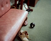 Shoes and a bowling ball in a changing room