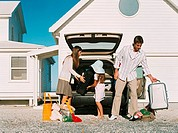 Family unpacking luggage from the car