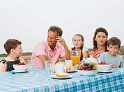 Family having breakfast al fresco