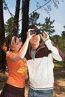 Young couple using binoculars