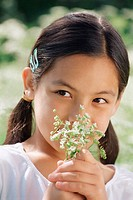 Girl smelling cow parsley
