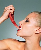Woman biting into tuna steak