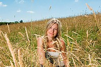 Woman crouching in a field