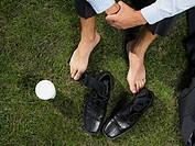 Businessman sitting on the grass