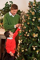 Father and son decorating a christmas tree