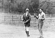 During the 1970s Prince Charles (born 1948) was an eligible bachelor, romantically linked to a series of young women. He is seen here angling with Car...
