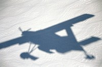Airplane shadow over snow, Aoraki/Mount Cook National Park, South Island, New Zealand