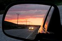 sunset reflection in car mirror