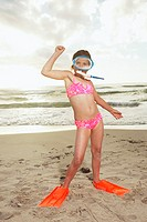 Young girl wearing swim mask and flippers