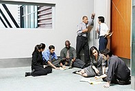 Businesspeople sitting on floor