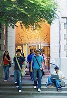 Group of college students leaving building