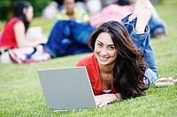 Female college student using laptop outdoors
