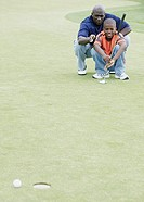 Father and son playing golf together