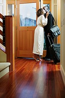 Couple kissing at door