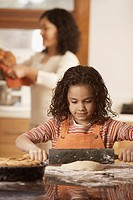 Girl baking with mother
