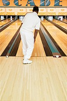 Rear view of man at bowling alley