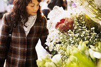 Woman looking at flowers (thumbnail)