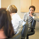 Portrait of businesswoman in meeting