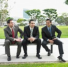 Three businessmen on park bench