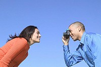 Man taking woman's photograph