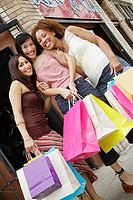 Portrait of three women shopping