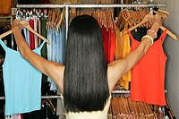 Rear view of woman clothes shopping