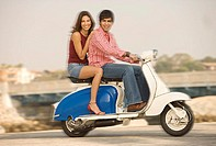 Couple riding on scooter, Playa del Rey, California, United States