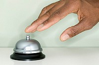 Close up of hand ringing service bell