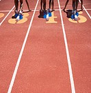 Female track athletes at starting line