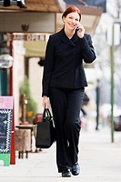 Businesswoman talking on cell phone outdoors