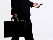 Businessman with cell phone and briefcase