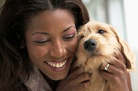 Close up of young woman holding dog