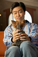 Man holding dog in lap