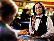 Woman dealer in casino