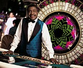 Male dealer at roulette wheel