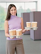 Businesswoman carrying coffee