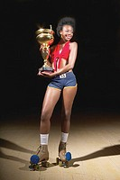 Woman on roller skates with trophy