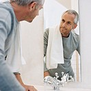Man looking at himself in mirror