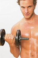 Shirtless man lifting weights