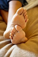 Woman's feet in bed