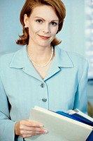 Portrait of a businesswoman holding files