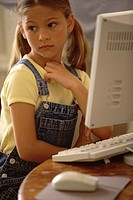 Girl sitting in front of a computer monitor