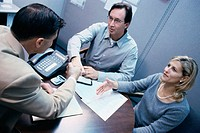 Three business executives in a meeting